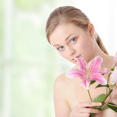 Beautiful woman with lily — Stock Photo
