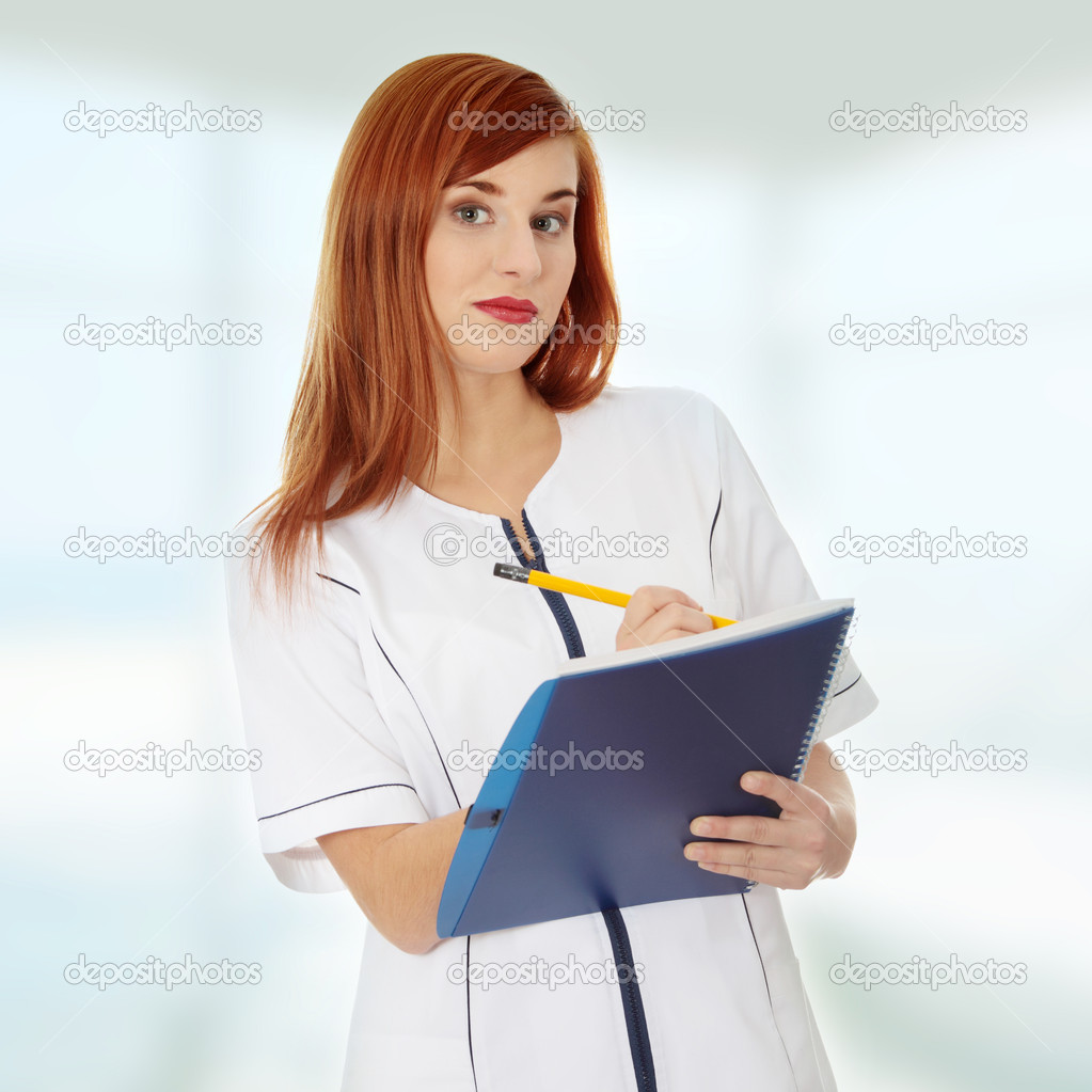 Smiling medical doctor or nurse.  Stock Photo #5064276