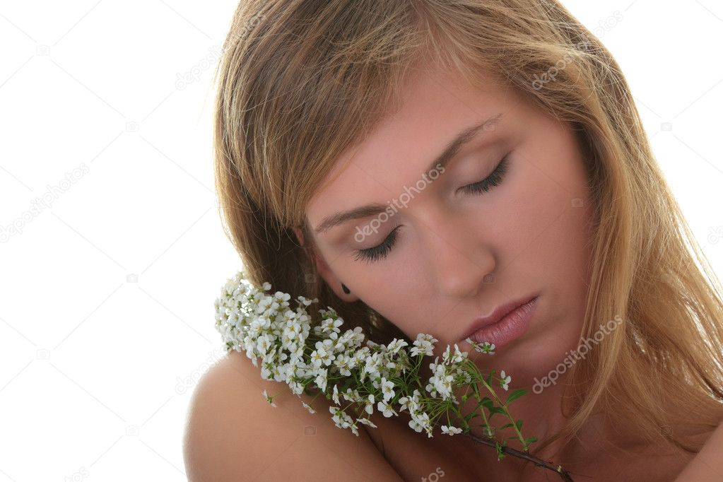 Beautiful blond woman with small white flowers isolated on white background — Stock Photo #5116331
