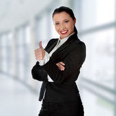 Confident business woman standing and gesturing ok — Stock Photo