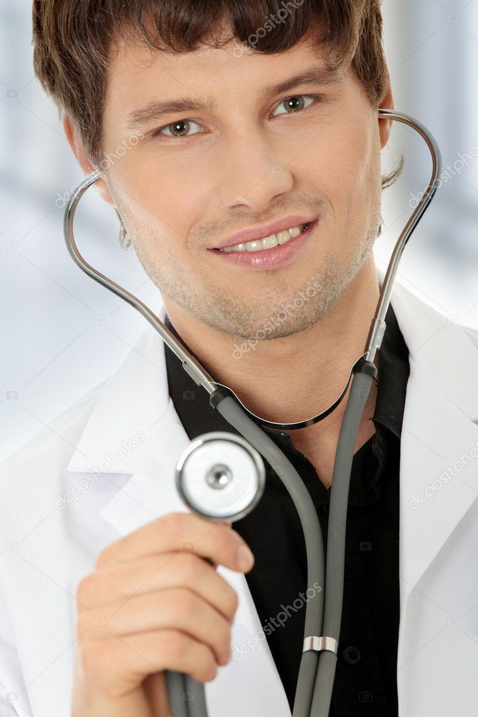 Handsome young doctor with stethoscope — Photo #5215224
