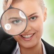 Business woman looking into a magnifying glass — Stock Photo #5231277