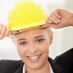 Confident female worker in helmet — Stock Photo #5231306