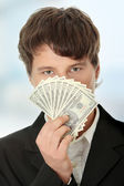 Young handsome businessman holding dollars — 图库照片