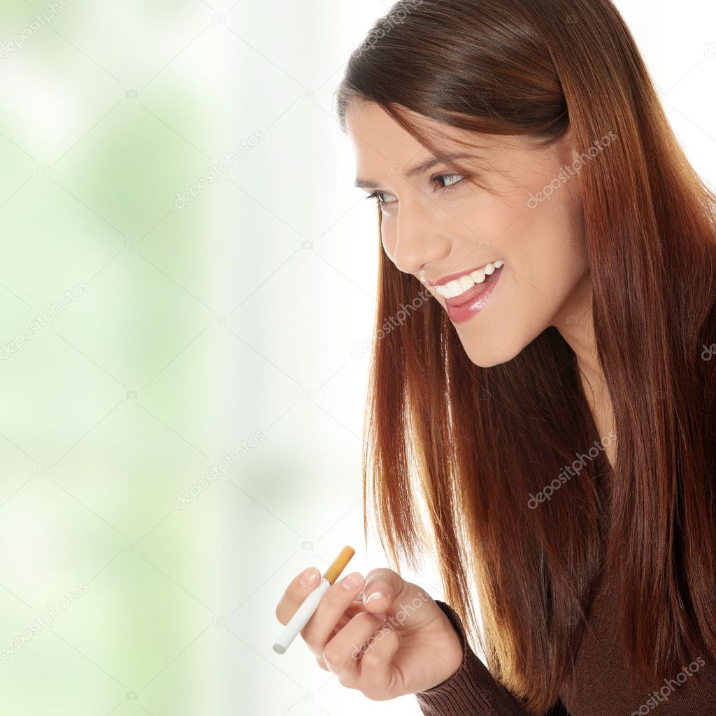 Young woman smoking electronic cigarette (ecigarette) — ストック写真 #5231963
