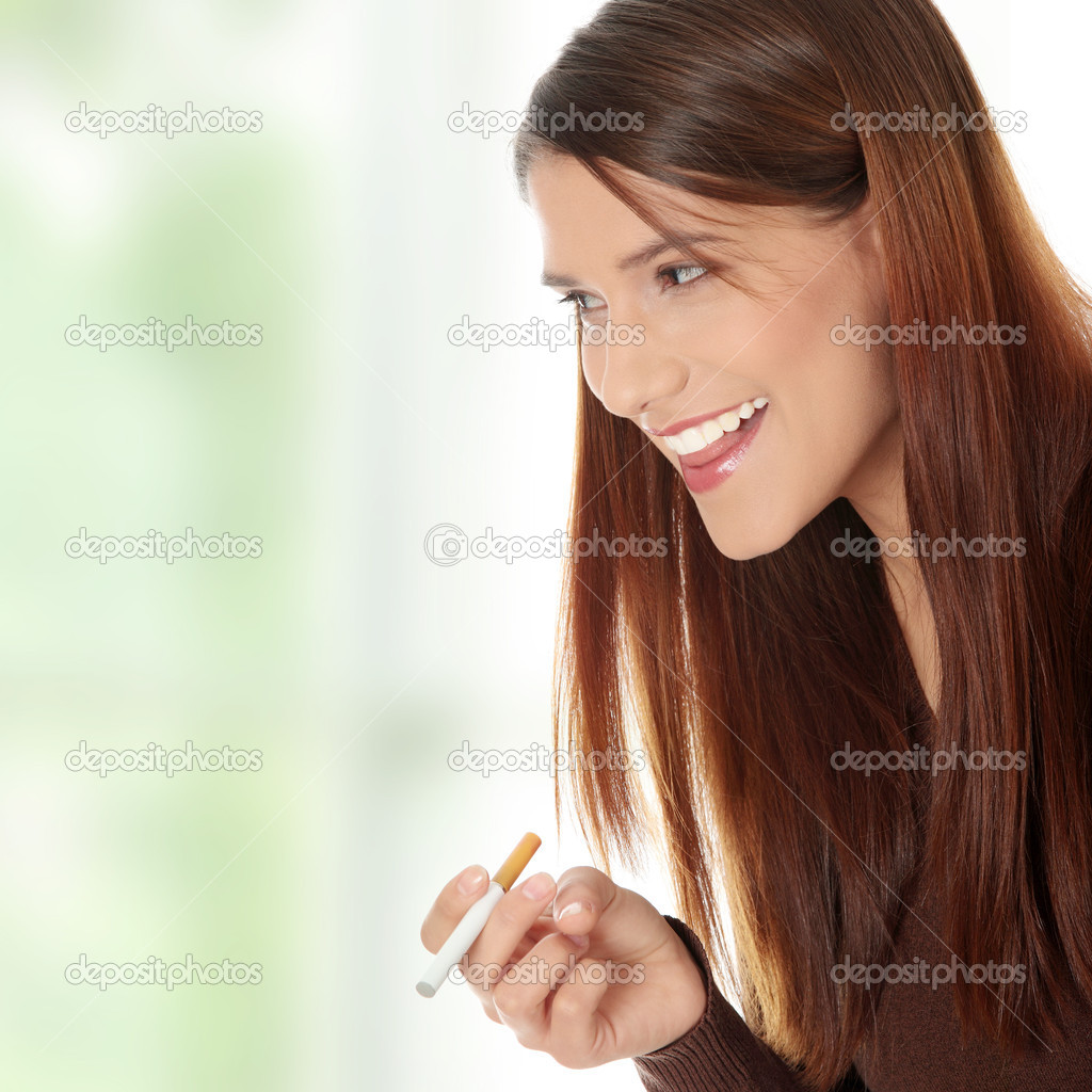 Young woman smoking electronic cigarette (ecigarette)  Stock Photo #5231963