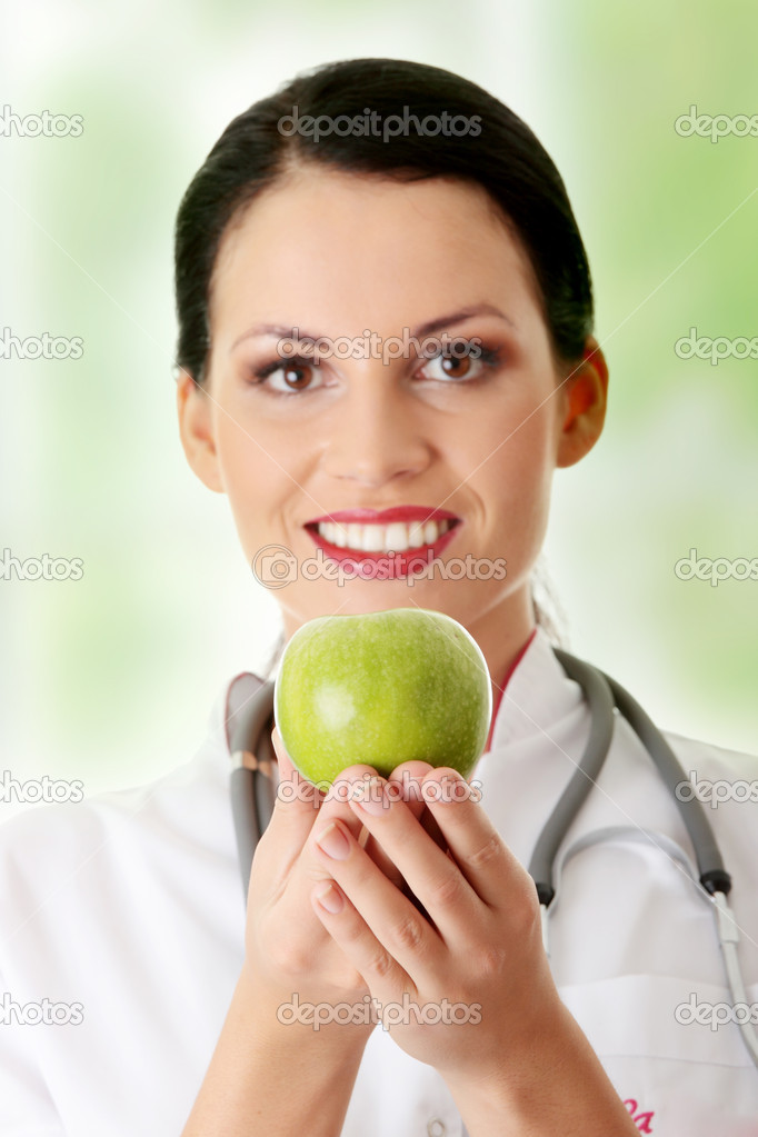 Healthy eating or lifestyle concept. Smiling woman doctor with a green apple. — Stock Photo #5232181