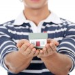 Young man with house's model. — Stock Photo
