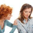 Troubled young girl comforted by her friend - Stock Photo