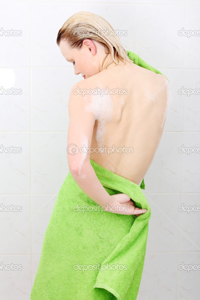 Beautiful woman  at bathroom, wipes her wet body with a towel — Stock Photo #5340673