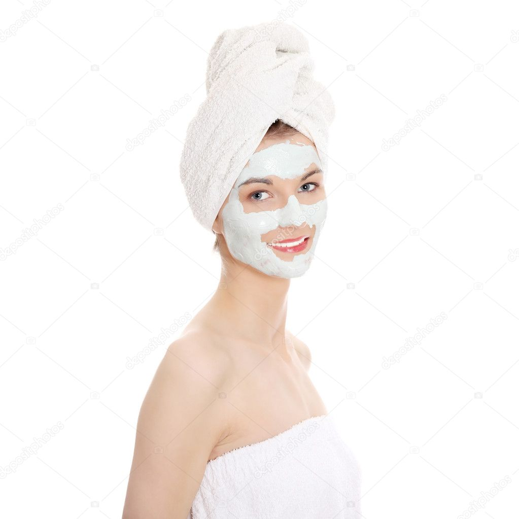 Cosmetics mask of clay on the beautiful young female face , isolated on white — Stock Photo #5341322
