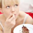 Eating chocolate cake — Stock Photo