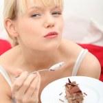 Eating chocolate cake — Stock Photo #5375155
