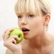 Beautiful woman with green apple — Stock Photo #5375162