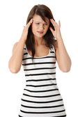 Young woman with headache — Stock Photo