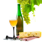 Bottle of wine, glass and grapes — Stock Photo
