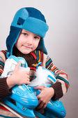 Boy keeps his skates — Stock Photo