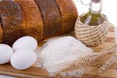 Fresh bread, eggs, flour and oil — Stock Photo