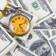 Stock Photo: Pocket watch on stack of dollars