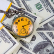 Pocket watch on a stack of dollars — Stockfoto