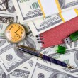 Stock Photo: Pocket watch, notebook and pen on stack of dollars