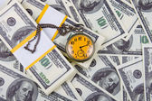 Pocket watch on a stack of dollars — Stock Photo