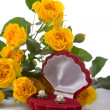 Beautiful yellow roses and box with a gift — Stock Photo #4946576