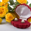 Beautiful yellow roses and box with a gift — Stock Photo #4946582