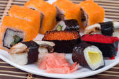 Traditional japanese sushi and rolls close up — Stock Photo