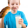Boy with a bread and milk — Stock Photo