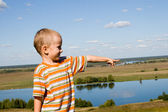 Small boy near the river — Stock Photo