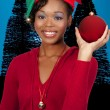 Foto Stock: Black Woman Holding a Christmas Ornament