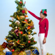 Foto de Stock  : Black Woman Holding a Christmas Ornament