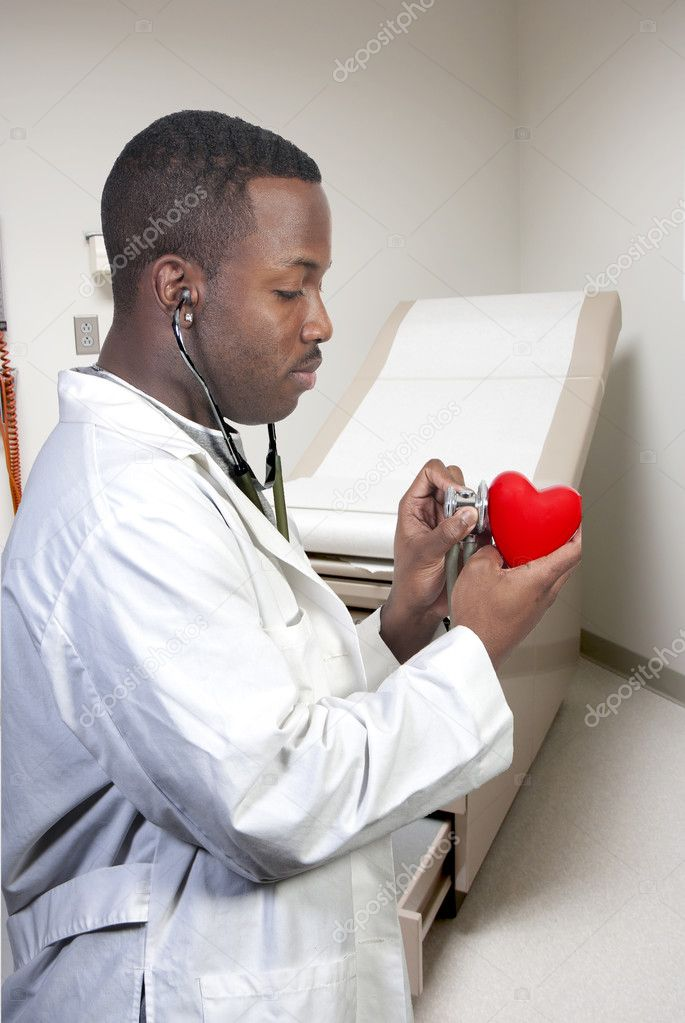 A black male African American doctor cardiologist holding a red heart  Stock Photo #4807610