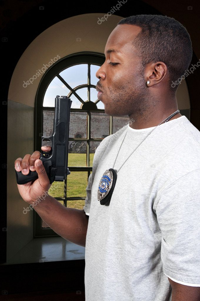 A black African American police detective man on the job with a gun — Stock Photo #4808286