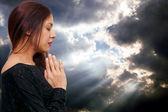 Hispanic Latino woman praying — Stock Photo