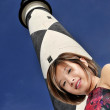 Asian Woman at a Lighthouse — Stock Photo #5369694