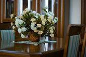 Decorative Flowers In Vase On Background A Window And Furniture. — Stock Photo