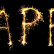 Word  HAPPY made of sparkler isolated on black - Stock Photo