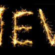 Word  NEW made of sparkler isolated on black - Stock Photo