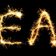 Word  YEAR made of sparkler isolated on black — Stock Photo