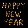 Happy New Year made of sparkles isolated on black - Stock Photo
