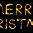 Merry Christmas made of sparkles isolated on black - Stock Photo