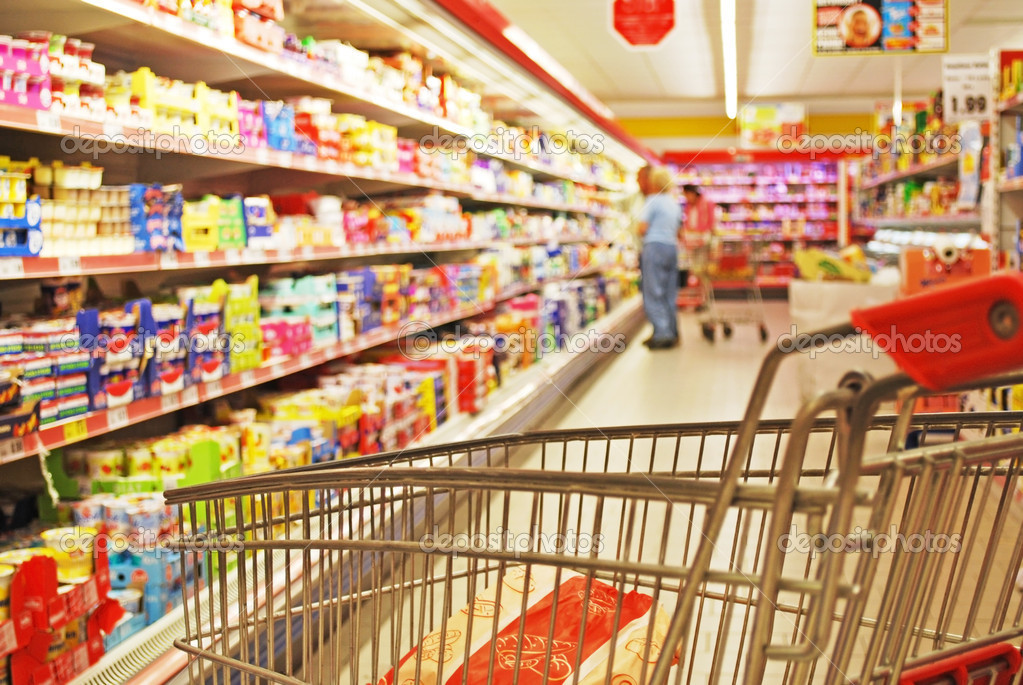 Aisle of a supermarket and food shelves, — Stock Photo #4021472