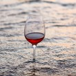 Wine glass in the sea — Stock Photo