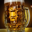 Good beer glass on yellow background — Stock Photo