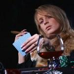 Beautiful woman playing poker — Stock Photo