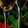 Two champagne glasses with red rose — Stock Photo #4195447