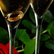 Two champagne glasses with red rose - Stock Photo