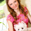 Beautiful woman with white dog - Stock Photo